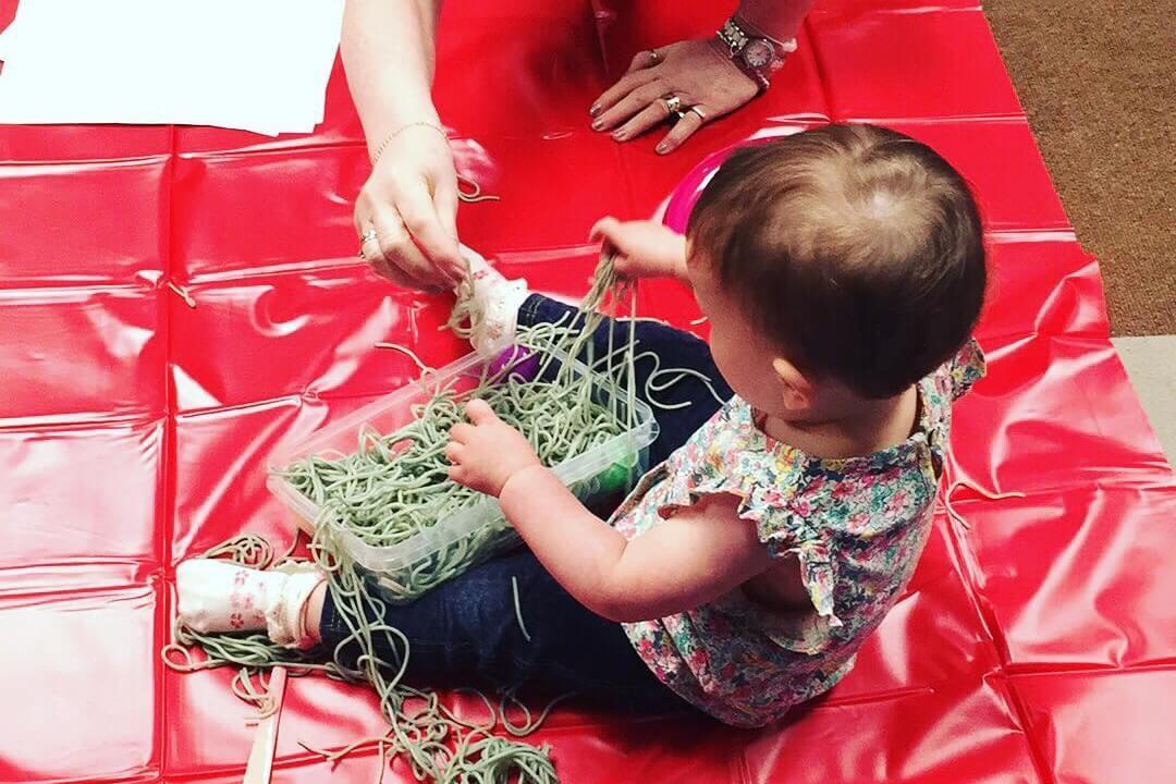 Kid playing with Spaghetti