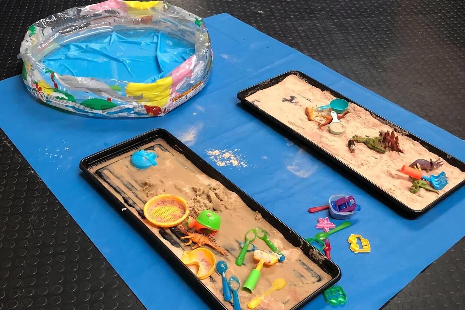 A indoor sand pit with army soldiers in